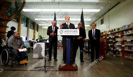 Pennsylvania Governor Tom Wolf speaks during a news conference at the John H. Taggart School library, in Philadelphia. Wolf discussed his infrastructure package, Restore Pennsylvania, to help remediate contaminants from Pennsylvania schools