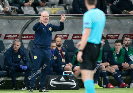 Stock Photo of Scotland's head coach Alex Mcleish gives instructions from the side line during the Euro 2020 group I qualifying soccer match between Kazakhstan and the Scotland at Astana Arena stadium in Astana, Kazakhstan