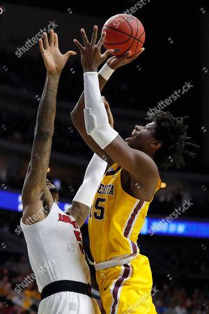 Malik Williams, Daniel Oturu. Minnesota center Daniel Oturu shoots over Louisville center Malik Williams, left, during a first round men's college basketball game in the NCAA Tournament, in Des Moines, Iowa