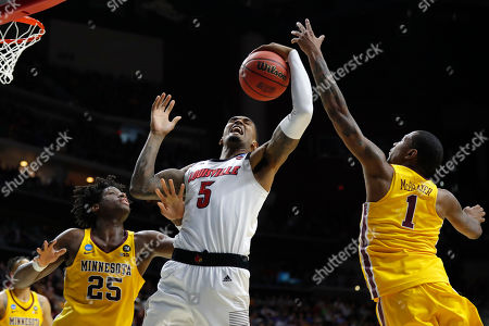 Louisville center Malik Williams (5) fights for a rebound with Minnesota's Daniel Oturu, left, and Dupree McBrayer, right, during a first round men's college basketball game in the NCAA Tournament, in Des Moines, Iowa