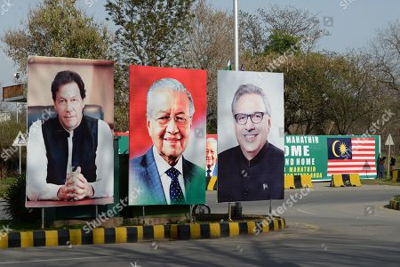 Posters of Malaysian Prime Minister Mahathir Mohamed (C), Pakistan's Prime Minister Imran Khan (L) and Pakistan's President Arif Alvi are placed on a road during the visit of Mahathir Mohamed to Islamabad, Pakistan, 21 March 2019. Mahathir Mohamed is on an official visit to Pakistan to attend the Pakistan Day Ceremonies as guest of honor.