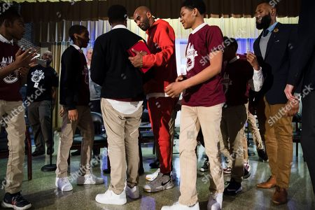Former Los Angeles Lakers NBA basketball player Kobe Bryant meets with students at Andrew Hamilton School in Philadelphia, . Kobe Bryant was promoting the book The Wizenard Series: Training Camp he created with writer Wesley King