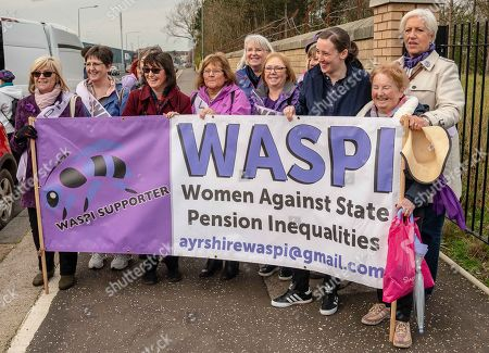 SNP MP Mhairi Black is seen holding a banner with other protesters during the demonstration.