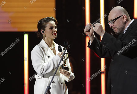 Stock Image of Russian singer Zivert (L) receives a trophy from Italian singer Mario Biondi (R) during the 2nd award ceremony of the International Professional Music Award 'BraVo' in the field of popular music at the State Kremlin Palace in Moscow, Russia, 21 March 2019.