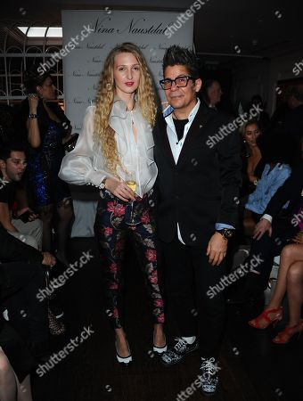 Joe Alverez and a model are seen during the LFW Nina Naustdal s/s19 catwalk show.