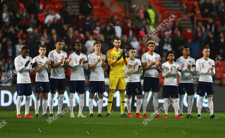 England Under 21 players stand for a minutes applause for the late Gordon Banks before kick off