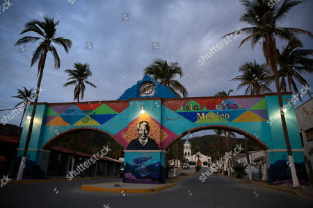 A mural of Nelson Mandela, who spent 18 of his 27 imprisoned years in an island prison in South Africa, adorns a gate in front of the dock where prison staff and inmates arrive in Navy boats to the now closed Islas Maria penal colony located off Mexico's Pacific coast, at dawn . Islas Marias was the last of its kind, the final of a half dozen island penal colonies that were scattered around Latin America