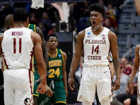 Terance Mann, David Nichols, Ben Shungu. Florida State's Terance Mann (14) celebrates with David Nichols (11) as Vermont's Ben Shungu (24) looks on during the second half of a first round men's college basketball game in the NCAA Tournament, in Hartford, Conn