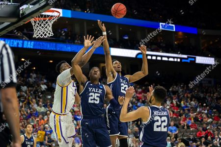Yale forward Jordan Bruner (23) and guard Miye Oni (25) fight for a rebound against LSU forward Kavell Bigby-Williams (11) during the second half of the first round men's college basketball game in the NCAA Tournament, in Jacksonville, Fla