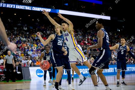 LSU guard Skylar Mays (4) is fouled by Yale forward Jordan Bruner, right, during the second half of the first round men's college basketball game in the NCAA Tournament, in Jacksonville, Fla