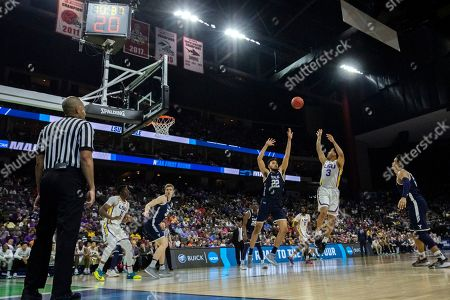 LSU guard Tremont Waters (3) shoots over Yale forward Austin Williams (22) during the second half of the first round men's college basketball game in the NCAA Tournament, in Jacksonville, Fla