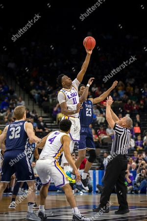 LSU forward Kavell Bigby-Williams (11) takes the tip off from Yale forward Jordan Bruner (23) during the first half of the first round men's college basketball game in the NCAA Tournament, in Jacksonville, Fla