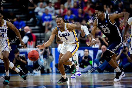 Stock Picture of LSU guard Javonte Smart (1) drives the ball against Yale forward Jordan Bruner (23) during the second half of the first round men's college basketball game in the NCAA Tournament, in Jacksonville, Fla