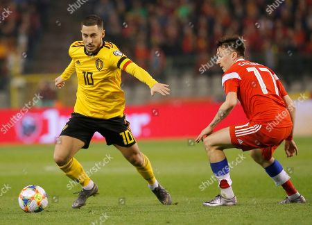 Belgium's Eden Hazard (L) and Russia's Aleksandr Golovin (R) fight for the ball during the UEFA EURO 2020 qualifier soccer match between Belgium and Russia at King Baudouin Stadium in Brussels, Belgium, 21 March 2019.