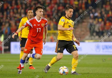 Russian Aleksandr Golovin (L) and Belgium's Dries Mertens (R) fight for the ball  during the UEFA EURO 2020 qualifier soccer match between Belgium and Russia at King Baudouin Stadium in Brussels, Belgium, 21 March 2019.
