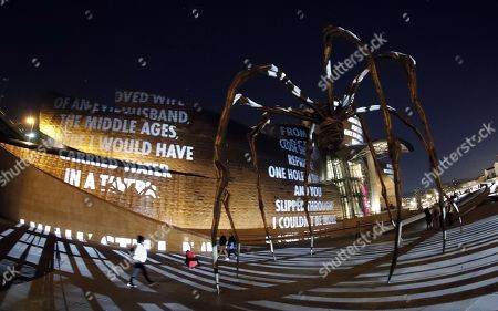 General view of a light installation projected in the facade of Guggenheim Bilbao Museum in Bilbao, Basque Country, northern Spain, 21 March 2019, on occasion of the opening of an exhibition of US conceptual artist Jenny Holzer.