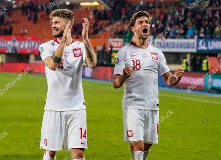 Mateusz Klich and Bartosz Bereszynski (L-R) of Poland celebrate after winning the UEFA Euro 2020 qualification soccer match between Austria and Poland in Vienna, Austria, 21 March 2019.