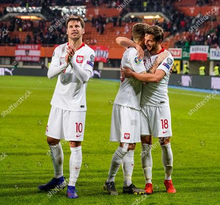 Grzegorz Krychowiak, Mateusz Klich and Bartosz Bereszynski (L-R) of Poland celebrate after winning the UEFA Euro 2020 qualification soccer match between Austria and Poland in Vienna, Austria, 21 March 2019.