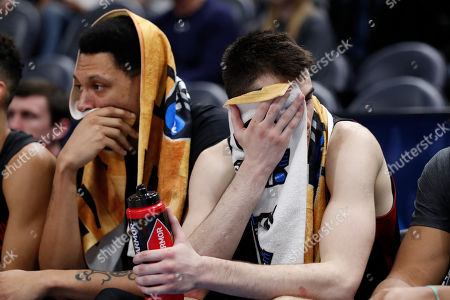 Northeastern forward Jeremy Miller, left, and guard Vasa Pusica sit the bench late in the second half during a first round men's college basketball game against the Kansas in the NCAA Tournament, in Salt Lake City