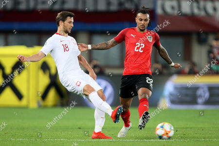 Stefan Lainer (R) of Austria in action against Bartosz Bereszynski (L) of Poland during the UEFA EURO 2020, Group G qualifying soccer match between Austria and Poland, in Vienna, Austria, 21 March 2019.