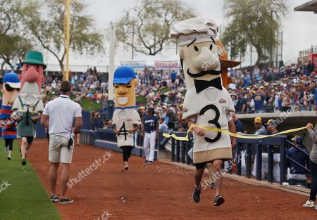 Italian sausage Guido wins the Milwaukee Brewers' sausage race before the bottom of the sixth inning during of a spring training baseball game between the Los Angeles Dodgers and the Brewers, in Phoenix