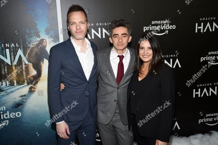 """Stock Picture of Jill Arthur, David Farr, Marc Resteghini. Amazon's Jill Arthur, left, and Marc Resteghini pose with writer and executive producer David Farr, center, at the premiere of Amazon Prime Video's """"Hannah"""" at The Whitby Hotel, in New York"""