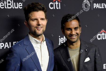 """Adam Scott, Aziz Ansari. Adam Scott, left, and Aziz Ansari arrive at the """"Parks and Recreation"""" 10th anniversary reunion during the 36th annual PaleyFest, at the Dolby Theatre in Los Angeles"""