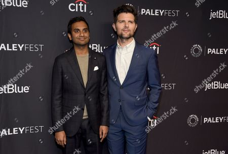 """Adam Scott, Aziz Ansari. Aziz Ansari, left, and Adam Scott arrive at the """"Parks and Recreation"""" 10th anniversary reunion during the 36th annual PaleyFest, at the Dolby Theatre in Los Angeles"""