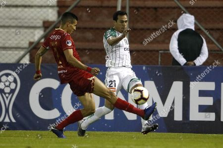 Aguilas Doradas' Daniel Munoz (L) vies for the ball with Oriente Petrolero's Julio Perez (R) during the Copa Sudamericana soccer match between Aguilas Doradas and Oriente Petrolero at Alberto Grisales stadium in Rionegro, Colombia, 21 March 2019.