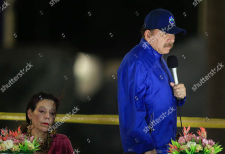 Daniel Ortega, Rosasio Murillo. Nicaragua's President Daniel Ortega speaks next to first lady and Vice President Rosario Murillo during the inauguration ceremony of a highway overpass in Managua, Nicaragua, . Ortega's government and opposition began negotiating Thursday how to carry out the release of hundreds of political prisoners arrested in the past year of unrest, after the government announced Wednesday it would free the prisoners within 90 days in exchange for the lifting of external sanctions