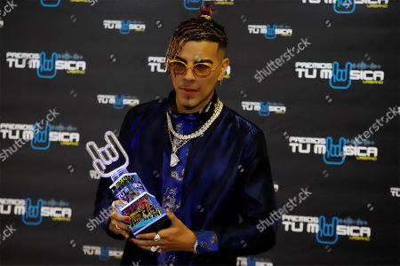 Puerto Rican reggaeton singer Tito 'El Bambino' poses for the media after receiving the Trajectory Award during the Tu Musica Urbano Awards in San Juan, Puerto Rico, 21 March 2019.