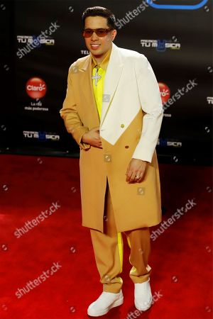 De La Ghetto poses upon his arrival at the Tu Musica Urbano Awards in San Juan, Puerto Rico, 21 March 2019.