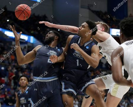 Elbert Robinson III, Jason Wade, Matt Haarms. Old Dominion's Elbert Robinson III, left, and Jason Wade (1) compete for a rebound with Purdue's Matt Haarms, back right, during the first half of a first-round game in the NCAA men's college basketball tournament, in Hartford, Conn