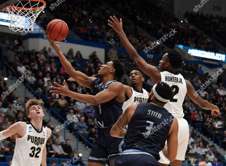 Old Dominion's Jason Wade goes up for a basket between the defense of Purdue's Aaron Wheeler and Eric Hunter Jr., right, during the first half of a first round men's college basketball game in the NCAA tournament, in Hartford, Conn