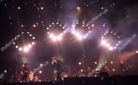Singer Enrique Bunbury performs at the Vive Latino music festival in Mexico City. The two-day rock festival is one of the most important and longest running of Mexico