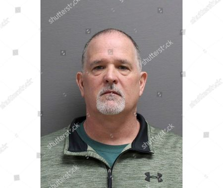 This March 21, 2019 booking photo provided by the Cascade County Sheriff's Office shows John Glen Stevens. The former undersheriff in northern Montana is accused of stealing firearms when he left his post for another job. The Great Falls Tribune reports former Cascade County Undersheriff Stevens was arrested, on a felony charge of theft for allegedly taking county owned firearms when he left the office in January 2018