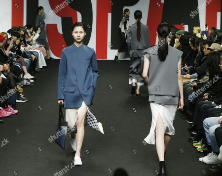 Stock Photo of Models exhibit creations by South Korean designer Lim Sun-ok of PARTs-PARTs during the Fall/Winter 2019 Seoul Fashion Week at the Dongdaemun design Plaza in Seoul, South Korea, 22 March 2019. The fashion week runs from 19 to 24 March.