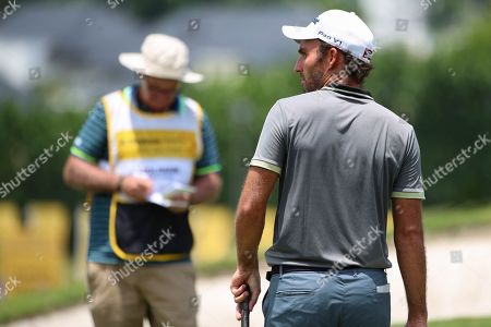 Edoardo Molinari of Italy (R) reacts during round two of the Malaysia Maybank Golf Championship at the Saujana Golf & Country Club in Kuala Lumpur, Malaysia, 22 March 2019.