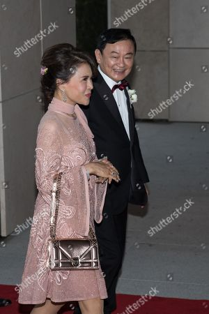 Thai Princess Ubolratana Barnavadi (L) arrives at the Rosewood Hong Kong Hotel escorted by exiled billionaire and former Thai Prime Minister Thaksin Shinawatra (R) in Hong Kong, China, 22 March 2019. Thai Princess Ubolratana Barnavadi, former Thai Prime Minister Thaksin Shinawatra, and former Thai Prime Minister Yingluck Shinawatra are in Hong Kong to attend Thaksin's youngest daughter Peatongtarn Shinawatra's wedding to pilot Pidok Sooksawas.