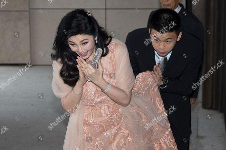 Former Thai Prime Minister Yingluck Shinawatra arrives at the Rosewood Hong Kong Hotel in Hong Kong, China, 22 March 2019. Thai Princess Ubolratana Barnavadi, former Thai Prime Minister Thaksin Shinawatra, and former Thai Prime Minister Yingluck Shinawatra are in Hong Kong to attend Thaksin's youngest daughter Peatongtarn Shinawatra's wedding to pilot Pidok Sooksawas.