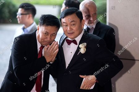 Exiled billionaire and former Thai Prime Minister Thaksin Shinawatra (R) welcomes guests as they arrive the Rosewood Hong Kong Hotel in Hong Kong, China, 22 March 2019. Thai Princess Ubolratana Barnavadi, former Thai Prime Minister Thaksin Shinawatra, and former Thai Prime Minister Yingluck Shinawatra are in Hong Kong to attend Thaksin's youngest daughter Peatongtarn Shinawatra's wedding to pilot Pidok Sooksawas.