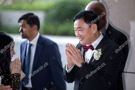 Exiled billionaire and former Thai Prime Minister Thaksin Shinawatra (R) welcomes guests as they arrive at the Rosewood Hong Kong Hotel in Hong Kong, China, 22 March 2019. Thai Princess Ubolratana Barnavadi, former Thai Prime Minister Thaksin Shinawatra, and former Thai Prime Minister Yingluck Shinawatra are in Hong Kong to attend Thaksin's youngest daughter Peatongtarn Shinawatra's wedding to pilot Pidok Sooksawas.