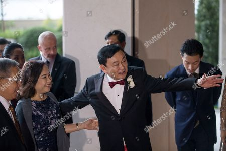 Exiled billionaire and former Thai Prime Minister Thaksin Shinawatra (C) welcomes guests as they arrive at the Rosewood Hong Kong Hotel in Hong Kong, China, 22 March 2019. Thai Princess Ubolratana Barnavadi, former Thai Prime Minister Thaksin Shinawatra, and former Thai Prime Minister Yingluck Shinawatra are in Hong Kong to attend Thaksin's youngest daughter Peatongtarn Shinawatra's wedding to pilot Pidok Sooksawas.