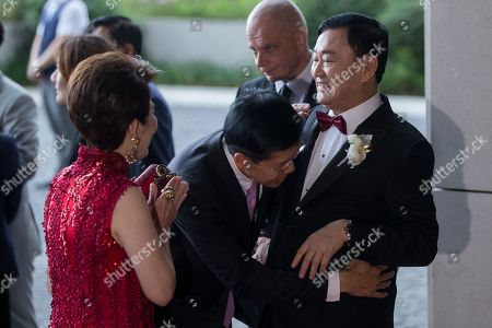 Stock Picture of Exiled billionaire and former Thai Prime Minister Thaksin Shinawatra (R) welcomes guests as they arrive at the Rosewood Hong Kong Hotel in Hong Kong, China, 22 March 2019. Thai Princess Ubolratana Barnavadi, former Thai Prime Minister Thaksin Shinawatra, and former Thai Prime Minister Yingluck Shinawatra are in Hong Kong to attend Thaksin's youngest daughter Peatongtarn Shinawatra's wedding to pilot Pidok Sooksawas.