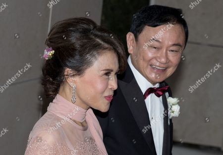 Stock Image of Thai Princess Ubolratana (L) arrives at the Rosewood Hong Kong Hotel escorted by exiled billionaire and former Thai Prime Minister Thaksin Shinawatra (R) in Hong Kong, China, 22 March 2019. Thai Princess Ubolratana, former Thai Prime Minister Thaksin Shinawatra, and former Thai Prime Minister Yingluck Shinawatra are in Hong Kong to attend Thaksin's youngest daughter Peatongtarn Shinawatra's wedding to pilot Pidok Sooksawas.