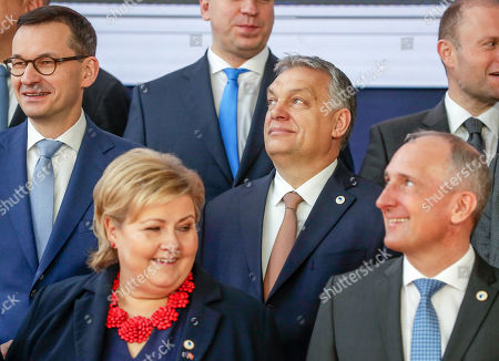 (L-R) Polish Prime Minister Matuesz Morawiecki, Norway's Prime Minister Erna Solberg, Hungarian Prime Minister Viktor Orban and Prime Minister of Liechtenstein Adrian Hasler attend a family photo at the European Council Summit in Brussels, Belgium, 22 March 2019. European Union leaders on 21 March agreed to extend Brexit untill 22 May 2019 if British MPs will approve Brexit agreement next week. If British Prime Minister May will lose the vote on Brexit deal for the third time, the delay will be until 12 April.