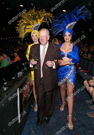 Stock Photo of Oscar Goodman and Showgirls