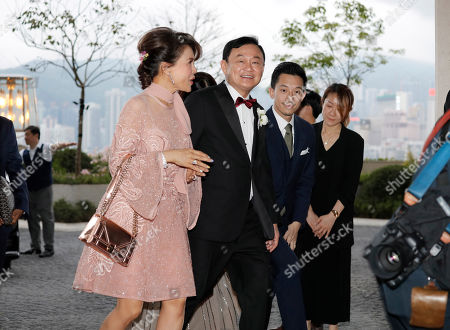 "Thaksin Shinawatra, Ubolratana. Former Thailand Prime Minister Thaksin Shinawatra, center, accompanies Princess Ubolratana of Thailand, center left, as they arrive for the wedding of Thaksin's youngest daughter Paetongtarn ""Ing"" Shinawatra at a hotel in Hong Kong"