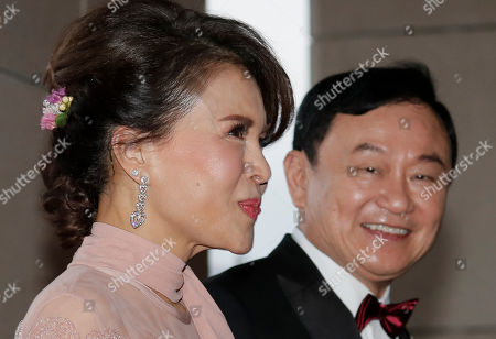 "Thaksin Shinawatra, Ubolratana. Former Thailand Prime Minister Thaksin Shinawatra, right, welcomes Princess Ubolratana of Thailand as they arrive for the wedding of Thaksin's youngest daughter Paetongtarn ""Ing"" Shinawatra at a hotel in Hong Kong"