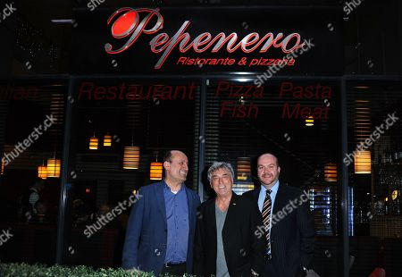 Bill Murray, Jonathan Sothcott and a guest arriving at Pepenero restaurant in Canning Town favoured by the former Eastender and other members of Eastenders cast